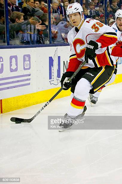Alex Chiasson of the Calgary Flames controls the puck during the game against the Columbus Blue Jackets on November 23 2016 at Nationwide Arena in...