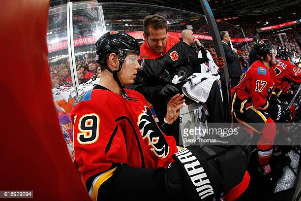 Alex Chiasson of the Calgary Flames has his hand looked at by a trainer during an NHL game against the Ottawa Senators on October 28 2016 at the...