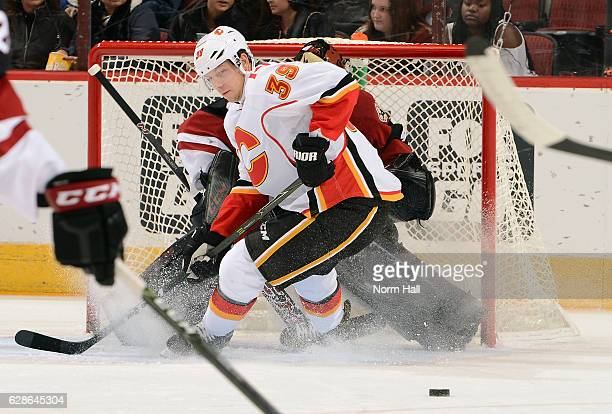 Alex Chiasson of the Calgary Flames looks for the puck as he positions himself in front of goalie Mike Smith of the Arizona Coyotes during the first...