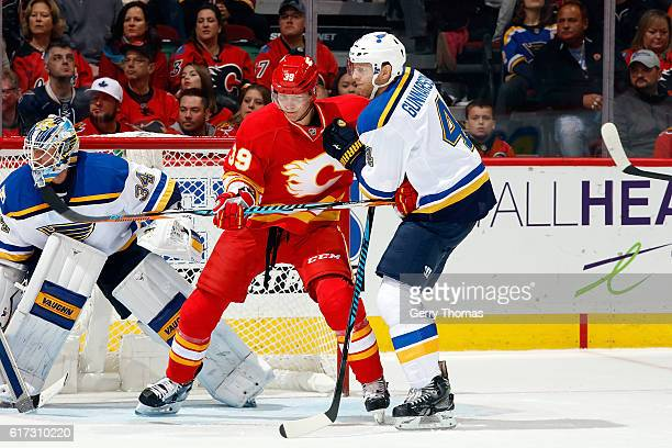 Alex Chiasson of the Calgary Flames skates against Carl Gunnarsson of the St Louis Blues during an NHL game on October 22 2016 at the Scotiabank...