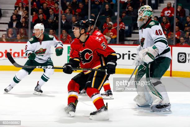 Alex Chiasson of the Calgary Flames skates against Devan Dubnyk of the Minnesota Wild during an NHL game on February 1 2017 at the Scotiabank...