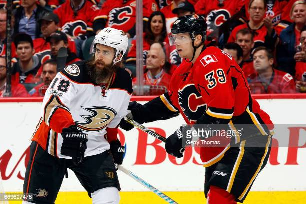 Alex Chiasson of the Calgary Flames skates against Patrick Eaves of the Anaheim Ducks during Game One of the Western Conference First Round during...