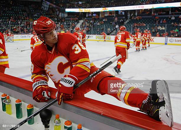 Alex Chiasson of the Calgary Flames stretches in warm up prior to the game against the Vancouver Canucks at Scotiabank Saddledome on January 7 2017...