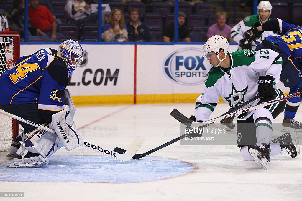 Alex Chiasson #12 of the Dallas Stars takes a shot on goal against Jake Allen #34 of the St. Louis Blues during a preseason at the Scottrade Center on September 21, 2013 in St. Louis, Missouri.