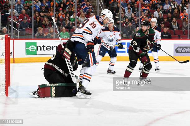 Alex Chiasson of the Edmonton Oilers attempts to screen goalie Darcy Kuemper of the Arizona Coyotes on a shot attempt during the first period at Gila...