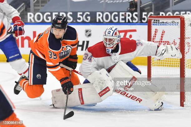 Alex Chiasson of the Edmonton Oilers battles for position against Jake Allen of the Montreal Canadiens on January 18, 2021 at Rogers Place in...