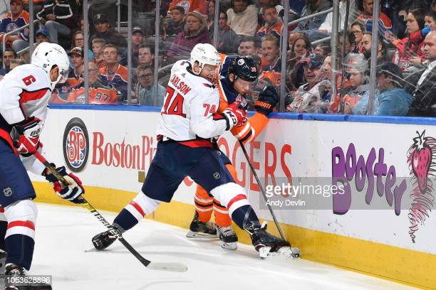 Alex Chiasson of the Edmonton Oilers battles for the puck against John Carlson of the Washington Capitals on October 25 2018 at Rogers Place in...