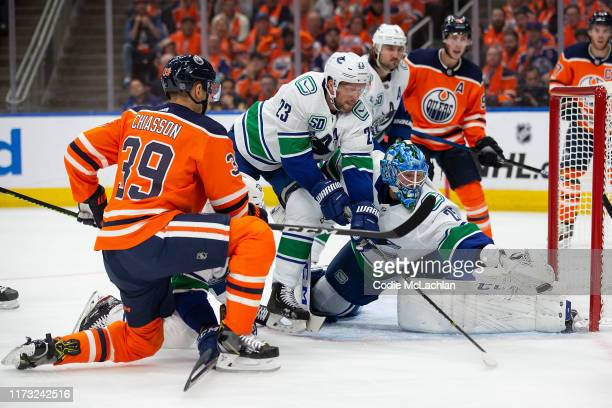 Alex Chiasson of the Edmonton Oilers can't get the puck past goaltender Jacob Markstrom of the Vancouver Canucks during the second period at Rogers...