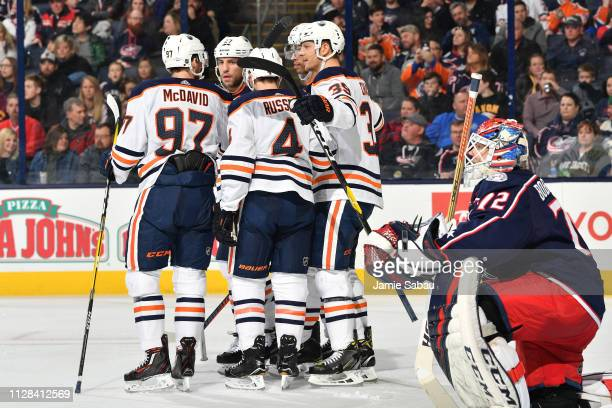 Alex Chiasson of the Edmonton Oilers celebrates his second period goal with his teammates during a game against the Columbus Blue Jackets on March 2...