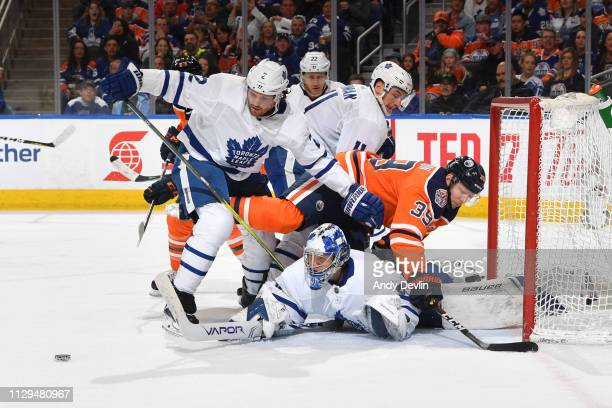 Alex Chiasson of the Edmonton Oilers collides with Frederik Andersen of the Toronto Maple Leafs on March 9 2019 at Rogers Place in Edmonton Alberta...