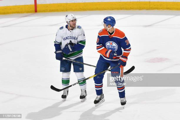 Alex Chiasson of the Edmonton Oilers exchanges words with Derrick Pouliot of the Vancouver Canucks on March 7 2019 at Rogers Place in Edmonton...