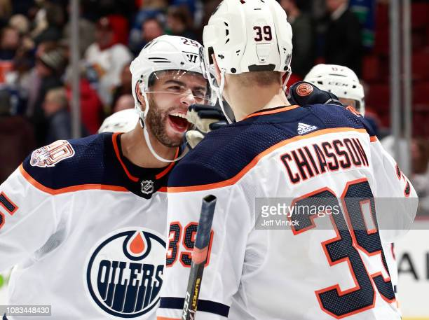 Alex Chiasson of the Edmonton Oilers is congratulated by teammate Darnell Nurse after scoring the game winning goal during their NHL game against the...