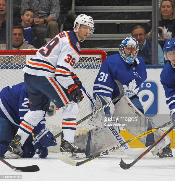 Alex Chiasson of the Edmonton Oilers looks for a puck to tip in front of Frederik Andersen of Toronto Maple Leafs during an NHL game at Scotiabank...