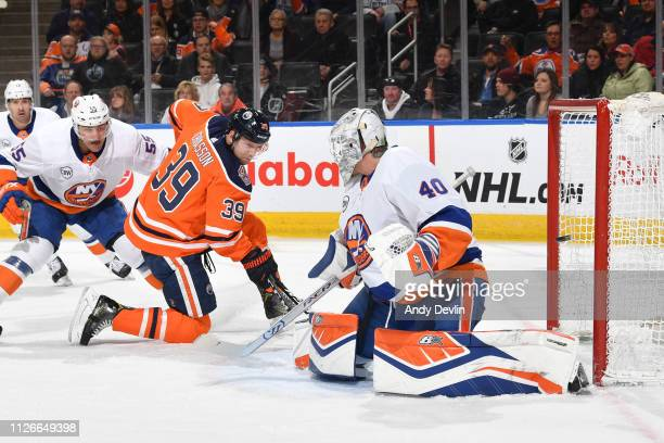 Alex Chiasson of the Edmonton Oilers scores a goal on Robin Lehner of the New York Islanders on February 21 2019 at Rogers Place in Edmonton Alberta...