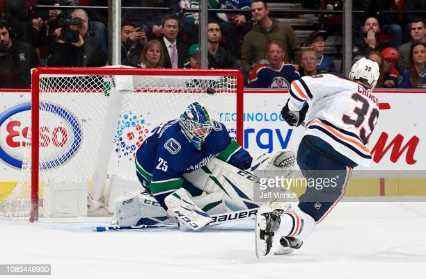 Alex Chiasson of the Edmonton Oilers scores on Jacob Markstrom of the Vancouver Canucks for the game winning goal in the shootout in overtime during...