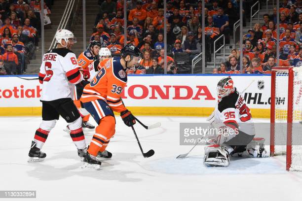 Alex Chiasson of the Edmonton Oilers shoots the puck past Cory Schneider of the New Jersey Devils on March 13 2019 at Rogers Place in Edmonton...