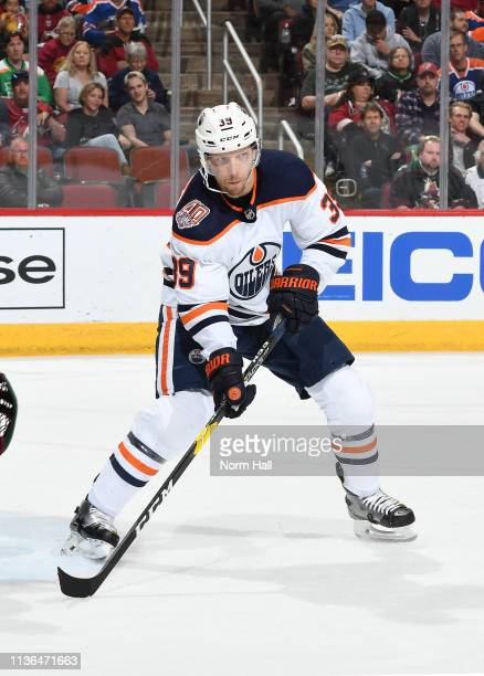 Alex Chiasson of the Edmonton Oilers skates after the puck during a game against the Arizona Coyotes at Gila River Arena on March 16 2019 in Glendale...