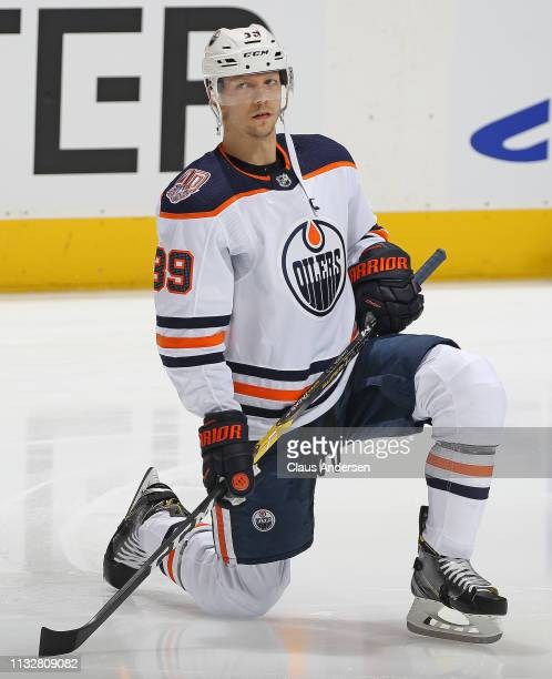 Alex Chiasson of the Edmonton Oilers stretches prior to action against the Toronto Maple Leafs in an NHL game at Scotiabank Arena on February 27 2019...