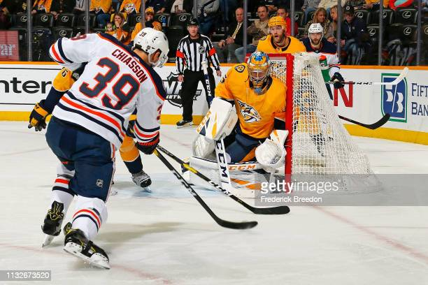 Alex Chiasson of the Edmonton Oilers takes a shot on goalie Pekka Rinne of the Nashville Predators during the second period at Bridgestone Arena on...