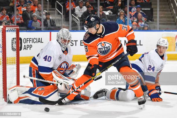 Alex Chiasson of the Edmonton Oilers takes a shot on Robin Lehner of the New York Islanders on February 21 2019 at Rogers Place in Edmonton Alberta...