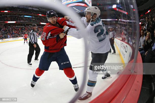 Alex Chiasson of the Washington Capitals and Barclay Goodrow of the San Jose Sharks fight during the third period at Capital One Arena on December 4...