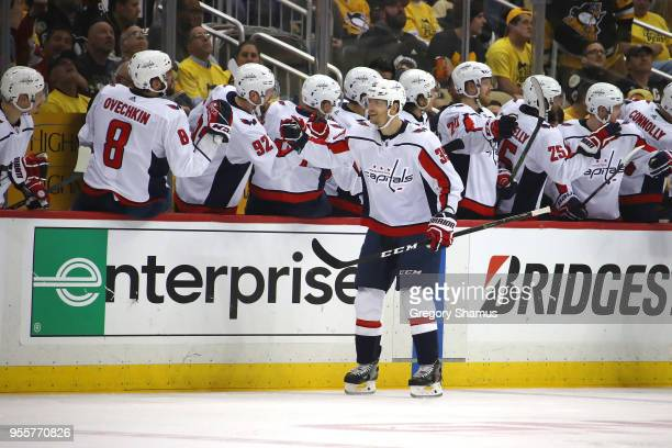 Alex Chiasson of the Washington Capitals celebrates his second period goal with teammates while playing the Pittsburgh Penguins in Game Six of the...
