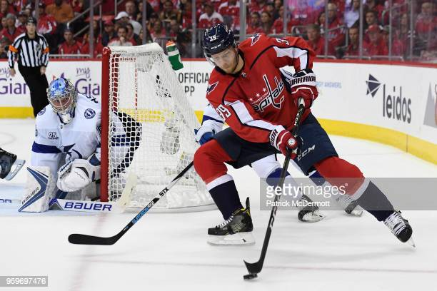 Alex Chiasson of the Washington Capitals controls the puck against JT Miller of the Tampa Bay Lightning in the first period in Game Three of the...