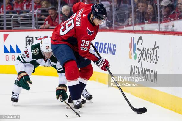 Alex Chiasson of the Washington Capitals controls the puck against Ryan Suter of the Minnesota Wild in the first period at Capital One Arena on...
