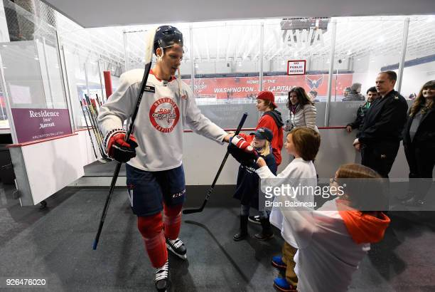Alex Chiasson of the Washington Capitals gives a fist bump to family members of the UHL after the Washington Capitals practice as part of the 2018...