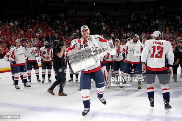 Alex Chiasson of the Washington Capitals hoists the Stanley Cup after his team defeated the Vegas Golden Knights 43 in Game Five of the 2018 NHL...