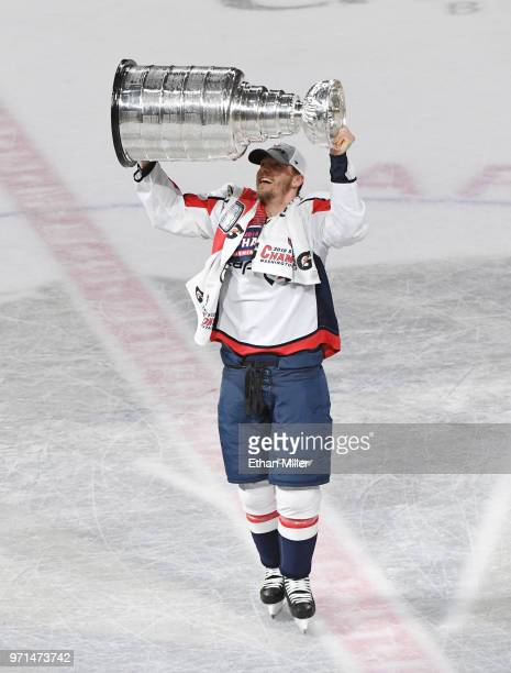 Alex Chiasson of the Washington Capitals hoists the Stanley Cup after Game Five of the 2018 NHL Stanley Cup Final at TMobile Arena on June 7 2018 in...