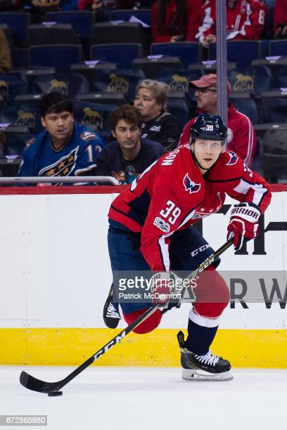 Alex Chiasson of the Washington Capitals skates with the puck in the first  period against the 7396c625fa4f