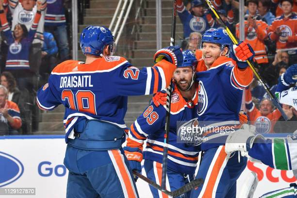 Alex Chiasson Sam Gagner and Leon Draisaitl of the Edmonton Oilers celebrate after a goal during the game against the Vancouver Canucks on March 7...
