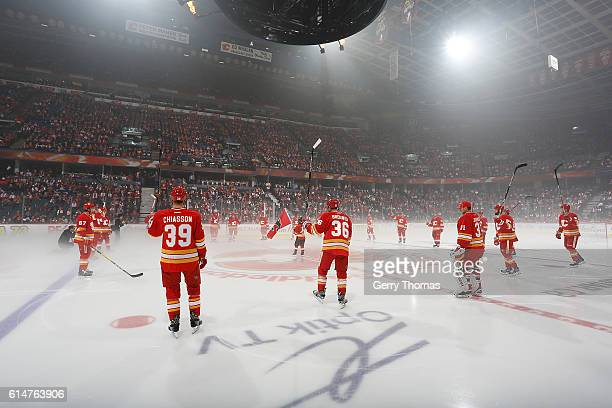 Alex Chiasson Troy Brouwer and teammates of the Calgary Flames salute the crowd before an NHL game against the Edmonton Oilers on October 14 2016 at...