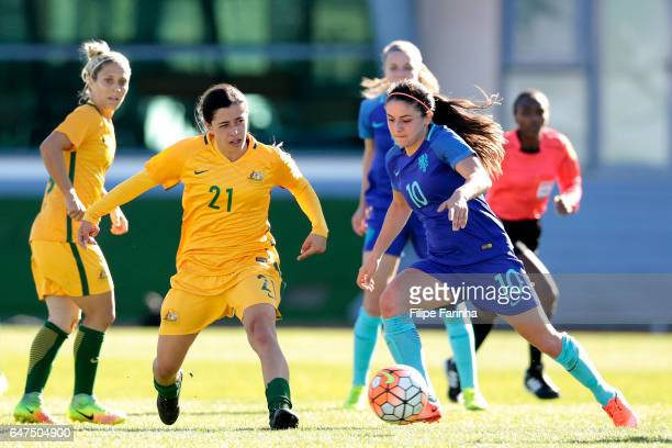 Alex Chidiac of Australia chalenges Danielle Van De Donk of Netherlands during the Algarve Cup Tournament Match between Australia W and Netherlands W...