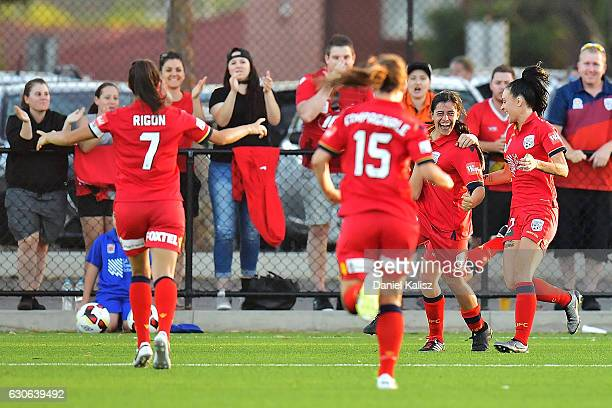 Alex Chidiac of United celebrates with her team mates after scoring a goal during the round nine WLeague match between Adelaide and Newcastle at...