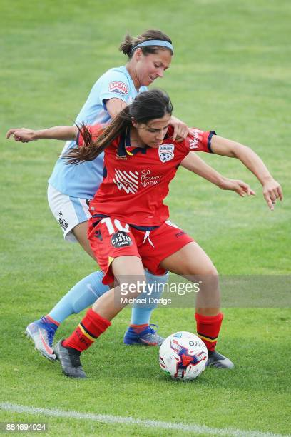 Alex Chidiac of United keeps control of the ball against Ashley Hatch of the City during the round six WLeague match between Melbourne City and...