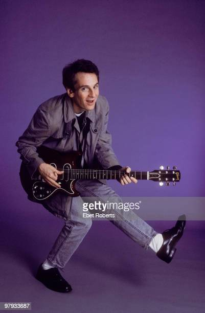 Alex Chilton posed with his guitar in the photographer's studio in New York City on September 01 1987