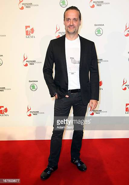 Alex Christensen arrives for the Deutscher Musikautorenpreis 2013 ceremony at the Ritz Carlton hotel on April 25 2013 in Berlin Germany The prize has...