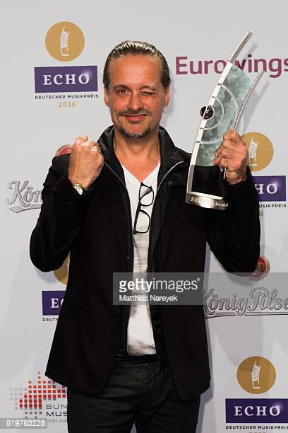 Alex Christensen poses with his award at the winners board during the Echo Award 2016 on April 7 2016 in Berlin Germany