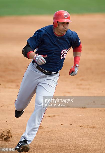 Alex Cintron of the Washington Nationals runs to third base against the Florida Marlins during a spring training game at Roger Dean Stadium on March...