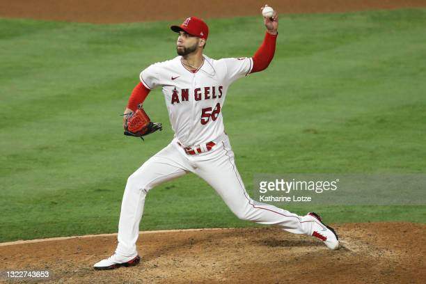 Alex Claudio of the Los Angeles Angels throws a pitch in the eighth inning against the Kansas City Royals at Angel Stadium of Anaheim on June 08,...