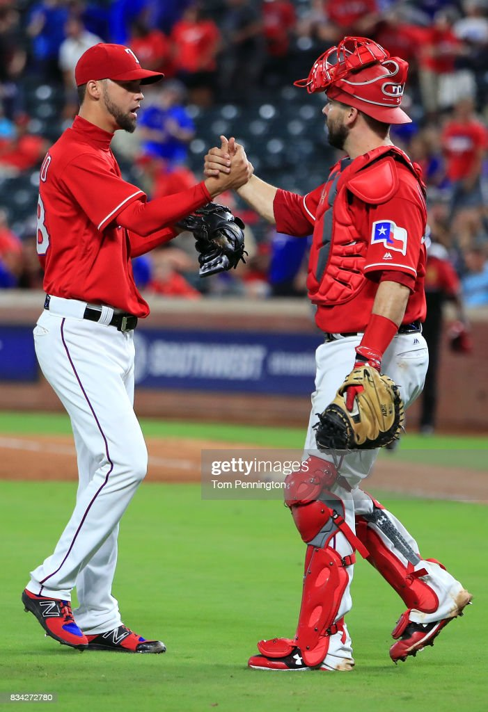 Alex Claudio #58 of the Texas Rangers celegbrates with Brett Nicholas #6 of the Texas Rangers after the Texas Rangers beat the Chicago White Sox 9-8 at Globe Life Park in Arlington on August 17, 2017 in Arlington, Texas.