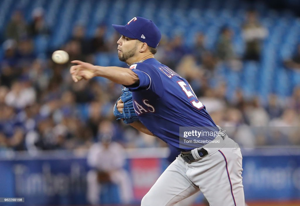 Alex Claudio #58 of the Texas Rangers delivers a pitch in the seventh inning during MLB game action against the Toronto Blue Jays at Rogers Centre on April 27, 2018 in Toronto, Canada.