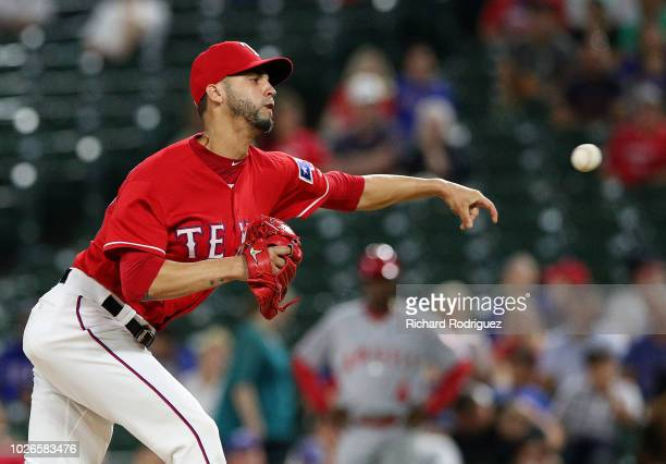 Alex Claudio of the Texas Rangers pitches in the ninth inning against the Los Angeles Angels at Globe Life Park in Arlington on September 3 2018 in...