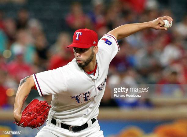 Alex Claudio of the Texas Rangers pitches in the seventh inning against the Tampa Bay Rays at Globe Life Park in Arlington on September 18 2018 in...