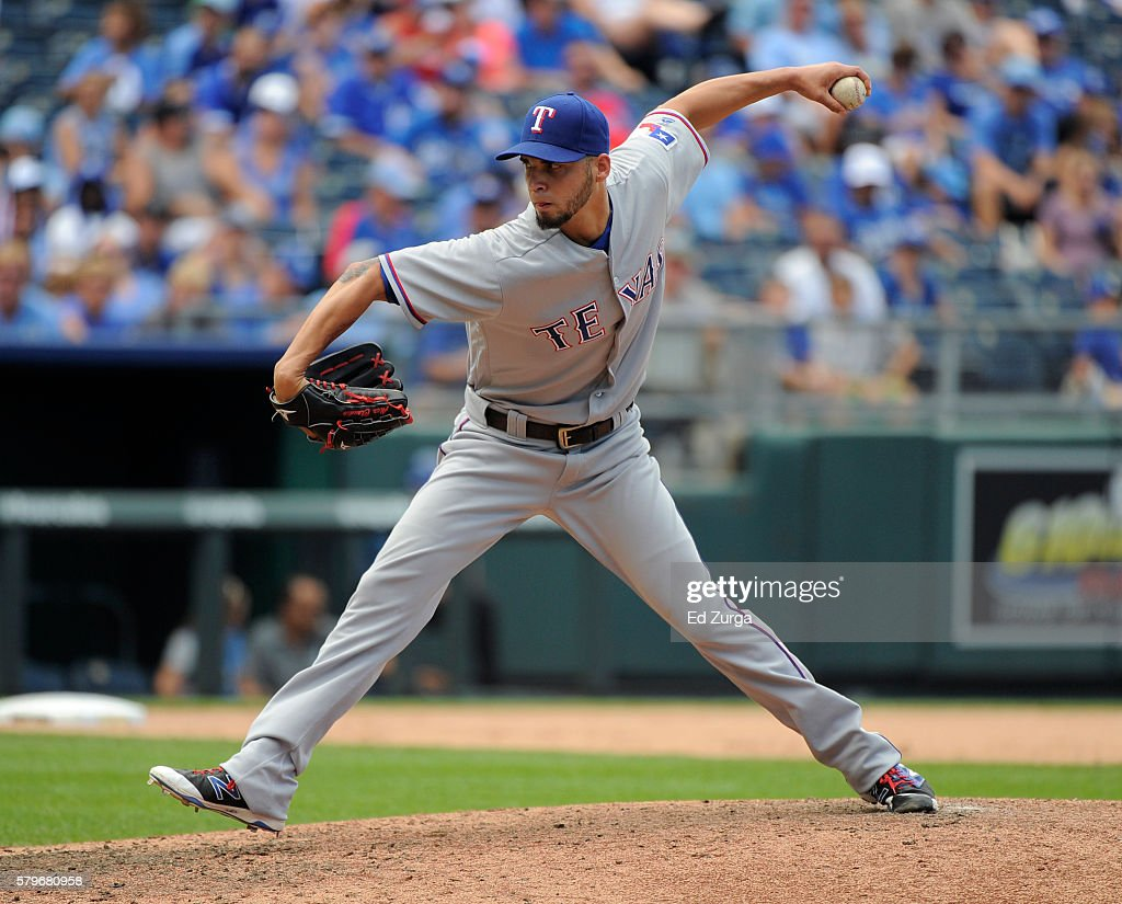 Alex Claudio #58 of the Texas Rangers pitches in the sixth inning against the Kansas City Royals at Kauffman Stadium on July 24, 2016 in Kansas City, Missouri.