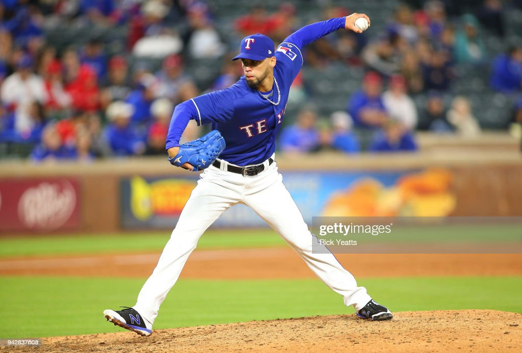 Alex Claudio #58 of the Texas Rangers \throws in the ninth inning against the Toronto Blue Jays at Globe Life Park in Arlington on April 6, 2018 in Arlington, Texas.