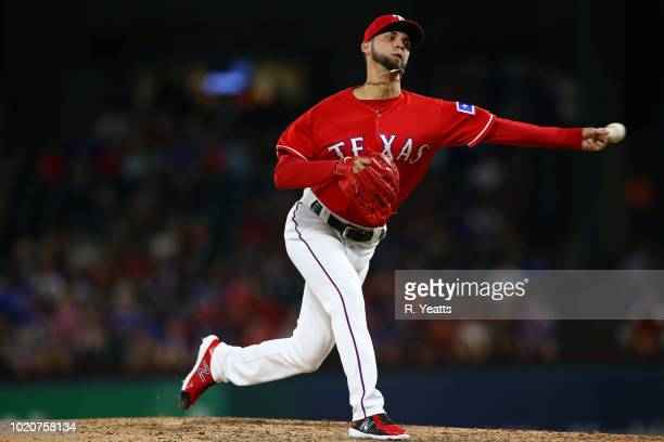 Alex Claudio of the Texas Rangers throws in the sixth inning against the Baltimore Orioles at Globe Life Park in Arlington on August 3 2018 in...