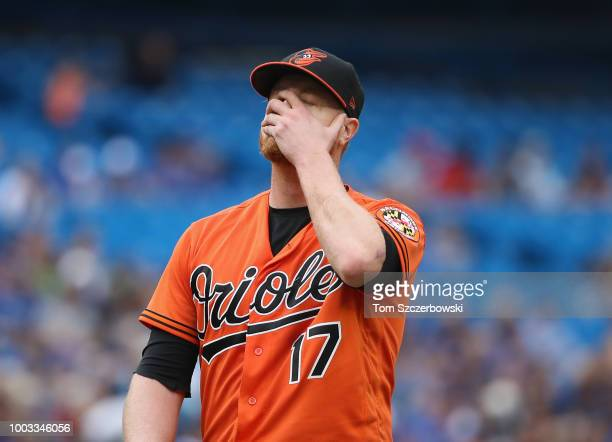 Alex Cobb of the Baltimore Orioles reacts as he walks off the mound at the end of the fifth inning after he balked in a run during MLB game action...